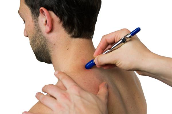 Man receiving IASTM treatment for headaches