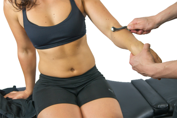 Treating tennis elbow with IASTM